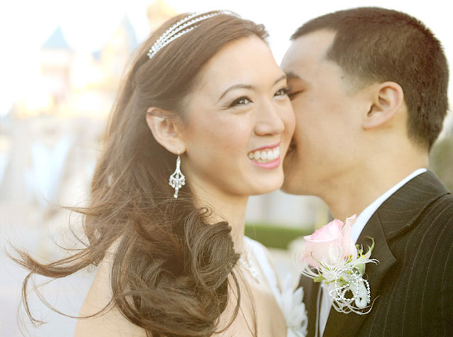 A groom kissing his bride on the cheek